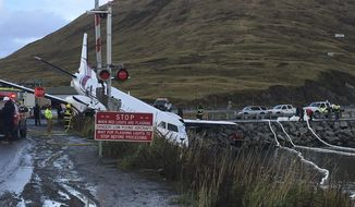 FILE - This Oct. 17, 2019, file photo shows a commuter airplane that crashed near the airport in a small Alaska community on the Bering Sea in Unalaska, Alaska. The flight crew of the plane that crashed in the remote Alaska community in October, fatally injuring a man, abandoned an initial landing attempt and faced stronger winds on their second try before the plane went off the runway, according to a federal report released Friday, Nov. 15. (Jim Paulin via AP, File)