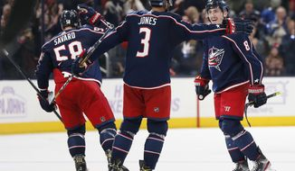 Columbus Blue Jackets' Zach Werenski, right, celebrates his winning goal against the St. Louis Blues with Seth Jones during the overtime period of an NHL hockey game Friday, Nov. 15, 2019, in Columbus, Ohio. (AP Photo/Jay LaPrete)
