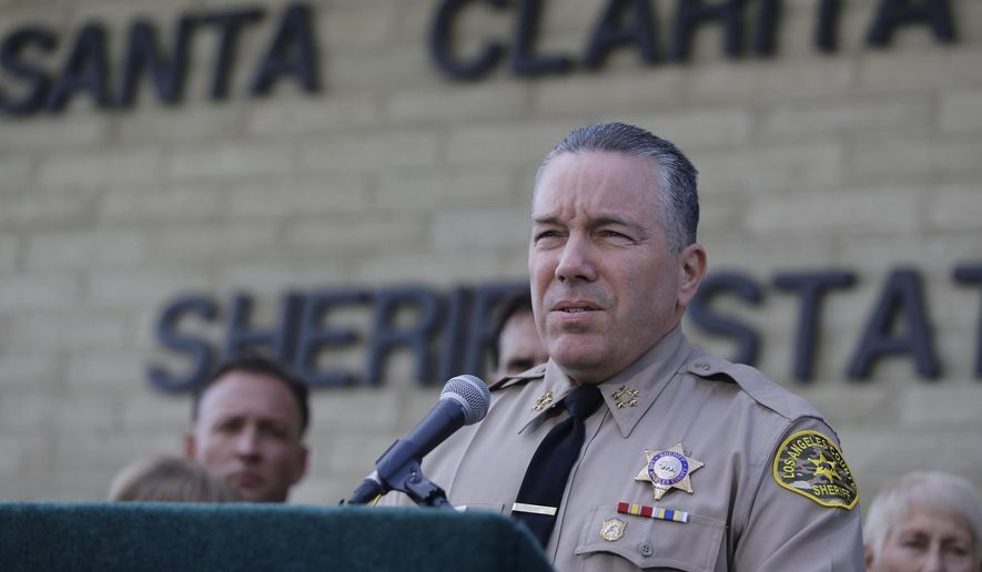 Los Angeles Sheriff Sheriff Alex Villanueva expresses his condolences for the victims of the shooting at Saugus High School at a news conference at the station Santa Clarita, Calif., Friday, Nov. 15, 2019. (AP Photo/Damian Dovarganes)