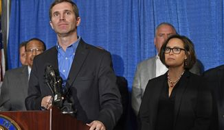 Kentucky Governor-Elect Andy Beshear, left, and Lt. Governor-Elect Jacqueline Coleman speak with reporters following the announcement of their transition team at the Capitol Rotunda in Frankfort, Ky., Friday, Nov. 15, 2019. (AP Photo/Timothy D. Easley)