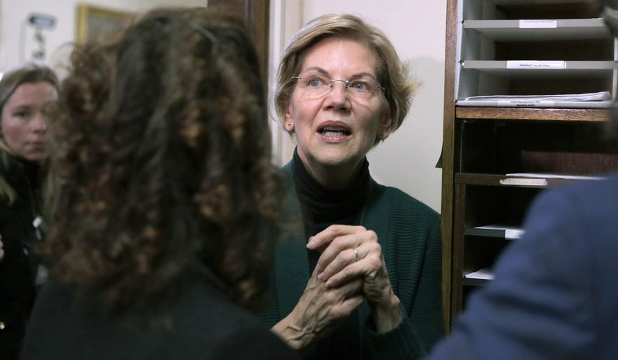 Democratic presidential candidate Sen. Elizabeth Warren, D-Mass., speaks with supporters after filing to have her name listed on the New Hampshire primary ballot, Wednesday, Nov. 13, 2019, in Concord, N.H. (AP Photo/Charles Krupa)