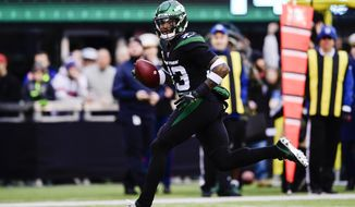New York Jets strong safety Jamal Adams (33) returns a fumble for a touchdown during the second half of an NFL football game against the New York Giants, Sunday, Nov. 10, 2019, in East Rutherford, N.J. (AP Photo/Steven Ryan)