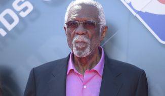 FILE - In this June 25, 2018, file photo, Bill Russell arrives at the NBA Awards at the Barker Hangar in Santa Monica, Calif. Russell says he is finally ready to be a Hall of Famer. The 11-time NBA champion, five-time MVP, Olympic gold medalist and two-time NCAA champ said on Twitter on Friday, Nov. 15, 2019, that he was presented with his Hall of Fame ring in a private ceremony that comes three decades after he was first selected for the shrine at Springfield, Mass. (Photo by Richard Shotwell/Invision/AP, File)