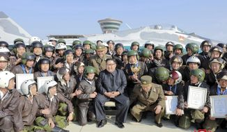 "In this undated photo provided on Saturday, Nov. 16, 2019 by the North Korean government, North Korean  leader Kim Jong Un, front center, poses with pilots during his inspection of a flight demonstration of military aircraft at an airfield in North Korea. Independent journalists were not given access to cover the event depicted in this image distributed by the North Korean government. The content of this image is as provided and cannot be independently verified. Korean language watermark on image as provided by source reads: ""KCNA"" which is the abbreviation for Korean Central News Agency. (Korean Central News Agency/Korea News Service via AP)"