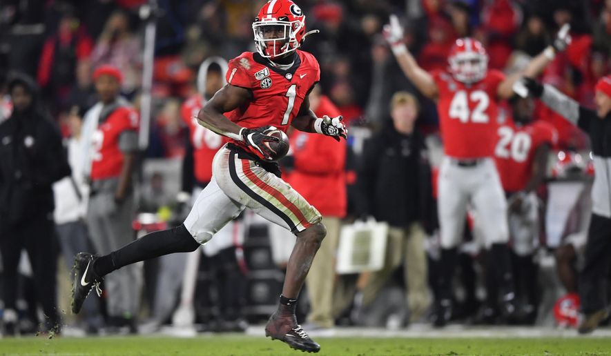 Georgia wide receiver George Pickens runs for a touchdown which was called back due to a penalty during the second half of an NCAA college football game against Missouri, Saturday, Nov. 9, 2019, in Athens, Ga. (AP Photo/John Amis)