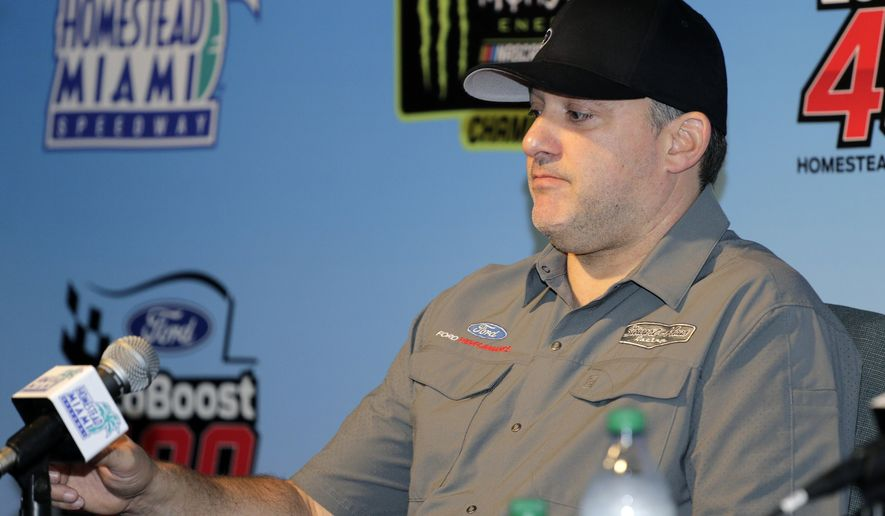 Team owner Tony Stewart takes questions during a NASCAR Cup Series auto race press conference Friday, Nov. 15, 2019, at Homestead-Miami Speedway in Homestead, Fla. Tony Stewart is set to become a NASCAR Hall of Famer. But adding another championship might mean even more.  (AP Photo/Terry Renna)