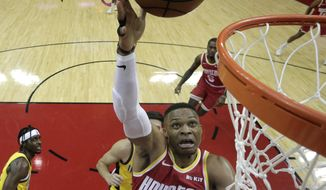 Houston Rockets' Russell Westbrook (0) shoots against the Indiana Pacers during the first half of an NBA basketball game Friday, Nov. 15, 2019, in Houston. (AP Photo/David J. Phillip)