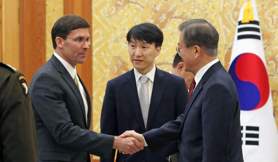 South Korean President Moon Jae-in, right, shakes hands with U.S. Defense Secretary Mark Esper, left, before a meeting at the presidential Blue House in Seoul, South Korea, Friday, Nov. 15, 2019. (Lee Jin-wook/Yonhap via AP)