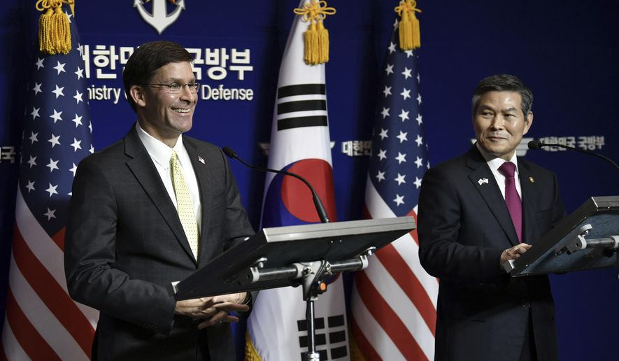 U.S. Defense Secretary Mark Esper, left, and South Korean Defense Minister Jeong Kyeong-doo, right, hold a joint press conference after the 51st Security Consultative Meeting (SCM) at the Defense Ministry in Seoul Friday, Nov. 15, 2019. U.S. Defense Secretary Esper says South Korea is wealthy enough to pay a bigger share of the cost of having U.S. troops on its soil. (Jung Yeon-je/Pool Photo via AP) **FILE**