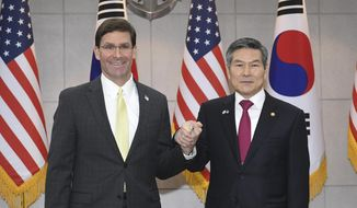 U.S. Defense Secretary Mark Esper, left, shakes hands with South Korean Defense Minister Jeong Kyeong-doo before their meeting Friday, Nov. 15, 2019, in Seoul, South Korea.  (Kim Min-hee/Pool Photo via AP) ** FILE **