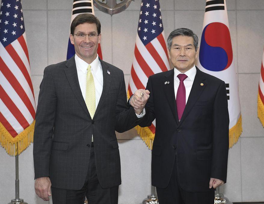 U.S. Defense Secretary Mark Esper, left, shakes hands with South Korean Defense Minister Jeong Kyeong-doo before their meeting Friday, Nov. 15, 2019, in Seoul, South Korea.  (Kim Min-hee/Pool Photo via AP) ** FILE **