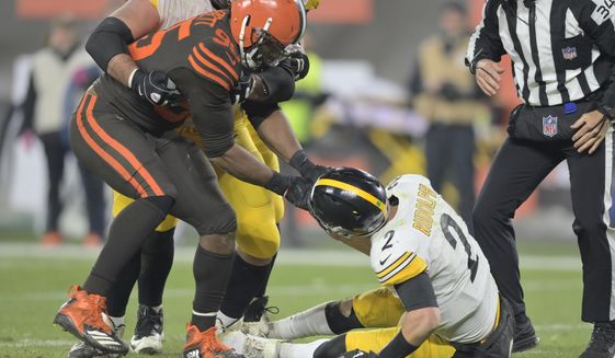 Cleveland Browns defensive end Myles Garrett (95) pulls the helmet off Pittsburgh Steelers quarterback Mason Rudolph (2) in the fourth quarter of an NFL football game, Thursday, Nov. 14, 2019, in Cleveland. The Browns won 21-7. (AP Photo/David Richard)