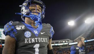 Kentucky quarterback Lynn Bowden Jr. (1) walks off the field after the team's NCAA college football game against Tennessee, Saturday, Nov. 9, 2019, in Lexington, Ky. (AP Photo/Bryan Woolston)