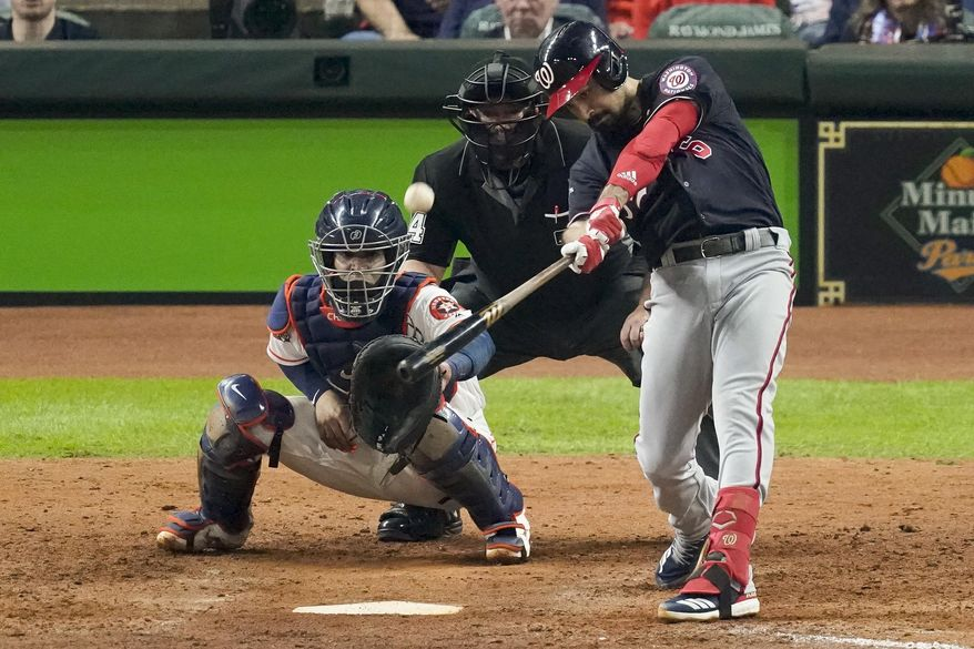 FILE - In this Oct. 29, 2019, file photo, Washington Nationals' Anthony Rendon hits a two-run home run against the Houston Astros during the seventh inning of Game 6 of the baseball World Series in Houston. An MVP finalist and a World Series champion, Rendon is clearly the crown jewel of this free agent class among position players - - although it is a reasonably strong group at third base this year. (AP Photo/Eric Gay, File)