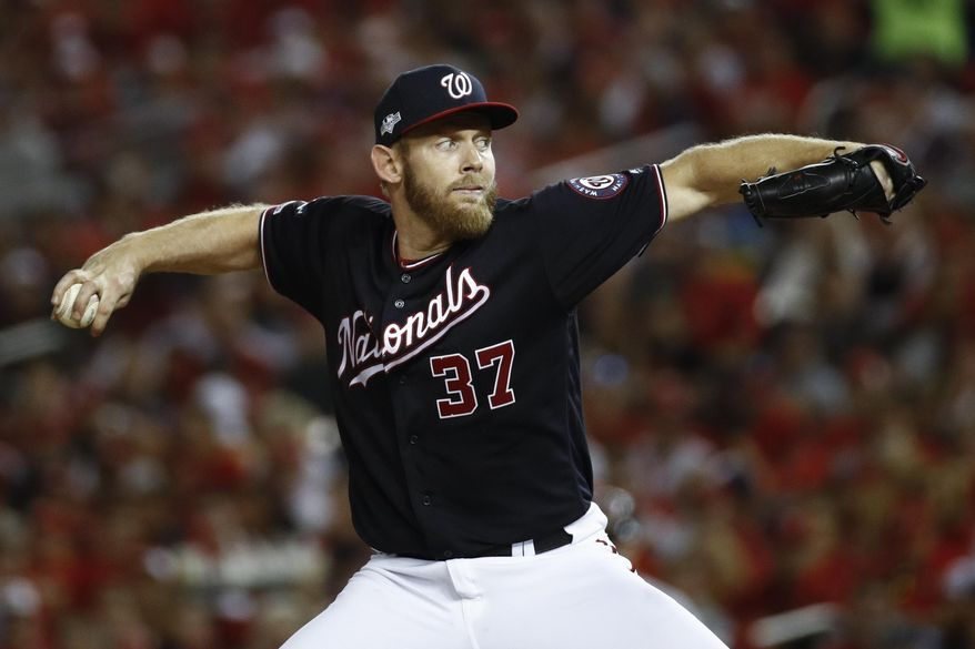 In this Oct. 14, 2019, file photo, Washington Nationals starting pitcher Stephen Strasburg throws during the fifth inning of Game 3 of the baseball National League Championship Series against the St. Louis Cardinals in Washington. The top picks from the 2011 and 2009 drafts are both available this offseason. Gerrit Cole gets the nod over Strasburg because he is two years younger. (AP Photo/Patrick Semansky) ** FILE **