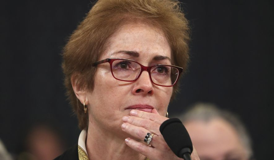 Former U.S. Ambassador to Ukraine Marie Yovanovitch listens as she testifies before the House Intelligence Committee on Capitol Hill in Washington, Friday, Nov. 15, 2019, during the second public impeachment hearing of President Donald Trump's efforts to tie U.S. aid for Ukraine to investigations of his political opponents. (AP Photo/Andrew Harnik) ** FILE **