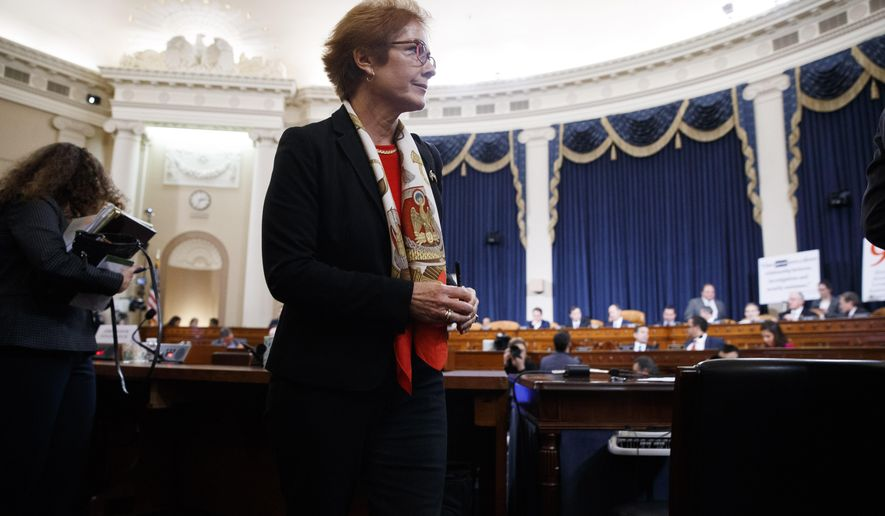 Former U.S. Ambassador to Ukraine Marie Yovanovitch gets up during a break in testimony before the House Intelligence Committee, Friday, Nov. 15, 2019, on Capitol Hill in Washington, in the second public impeachment hearing of President Donald Trump's efforts to tie U.S. aid for Ukraine to investigations of his political opponents. (AP Photo/Jacquelyn Martin)
