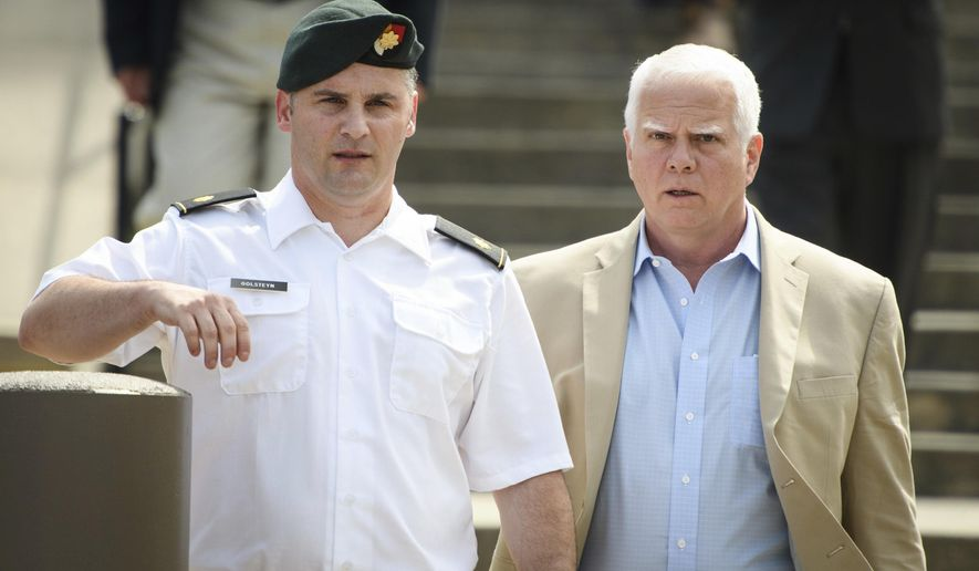 In this June 27, 2019, photo. Maj. Mathew Golsteyn, a former Army Special Forces soldier, leaves the Fort Bragg courtroom facility with his civilian lawyer, Phillip Stackhouse, right, after an arraignment hearing. President Donald Trump has pardoned a former U.S. Army commando set to stand trial next year in the killing of a suspected Afghan bomb-maker and for a former Army lieutenant who had been convicted of murder after he ordered his men to fire upon three Afghans, killing two, the White House announced late Friday. (Andrew Craft/The Fayetteville Observer via AP) **FILE**