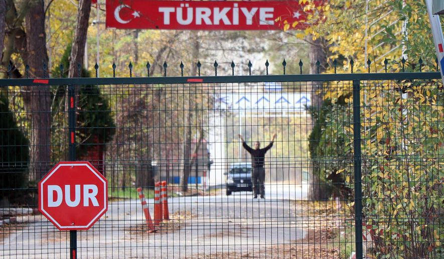 """An man who is identified by Turkish news reports as a U.S. citizen who has been deported by Turkey and is now stuck in the heavily militarized no-man's land between Greece and Turkey, after Greece refused to take him in, near Pazarkule border gate, Edirne, Turkey, Monday Nov. 11, 2019. Ankara began deporting captured foreign ISIS fighters, and asked to comment on the reports, Erdogan said: """"Whether they are stuck there at the border it doesn't concern us. We will continue to send them. Whether they take them or not, it is not our concern."""" (DHA via AP)"""