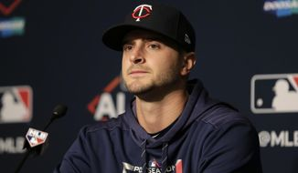 FILE - In this Saturday, Oct. 5, 2019, file photo, Minnesota Twins starting pitcher Jake Odorizzi talks to reporters during a baseball news conference at Yankee Stadium in New York. Odorizzi accepted Minnesota's one-year qualifying offer to put him under contract for 2020, after his first career All-Star game appearance. (AP Photo/Seth Wenig, File)