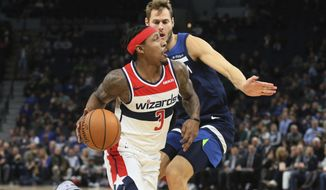 Washington Wizards' Bradley Beal (3) eyes the basket as he drives past Minnesota Timberwolves' Jake Layman in the second half of an NBA basketball game Friday, Nov 15, 2019, in Minneapolis. (AP Photo/Jim Mone) ** FILE **