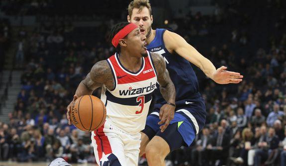 Washington Wizards' Bradley Beal (3) eyes the basket as he drives past Minnesota Timberwolves' Jake Layman in the second half of an NBA basketball game Friday, Nov 15, 2019, in Minneapolis. (AP Photo/Jim Mone) ** FILE **