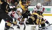Washington Capitals' T.J. Oshie (77) tries to get a shot past Boston Bruins' Jaroslav Halak (41) during the second period of an NHL hockey game in Boston, Saturday, Nov. 16, 2019. (AP Photo/Michael Dwyer) ** FILE **