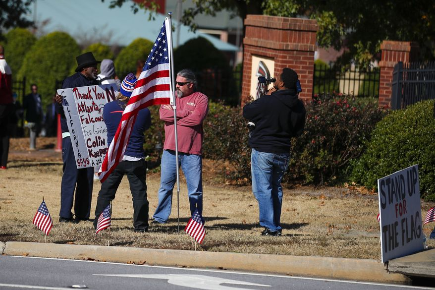 Protesters and supporters show up for a planned Colin Kaepernick workout for NFL football scouts Saturday, Nov. 16, 2019, in Flowery Branch, Ga.. (AP Photo/Todd Kirkland)