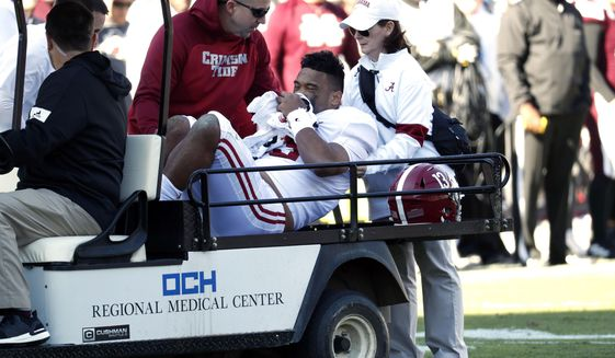 Alabama quarterback Tua Tagovailoa (13) is carted off the field after getting injured in the first half of an NCAA college football game against Mississippi State in Starkville, Miss., Saturday, Nov. 16, 2019. (AP Photo/Rogelio V. Solis)  **FILE**