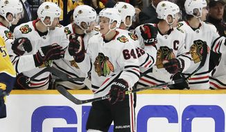 Chicago Blackhawks center David Kampf (64), of the Czech Republic, is congratulated after scoring a goal against the Nashville Predators in the second period of an NHL hockey game Saturday, Nov. 16, 2019, in Nashville, Tenn. (AP Photo/Mark Humphrey)