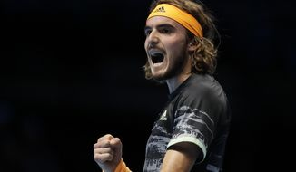 Stefanos Tsitsipas of Greece celebrates winning a point against Roger Federer of Switzerland during their ATP World Tour Finals semifinal tennis match at the O2 Arena in London, Saturday, Nov. 16, 2019. (AP Photo/Kirsty Wigglesworth)