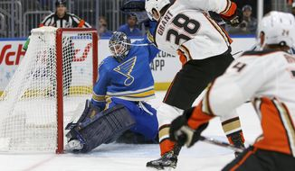 Anaheim Ducks' Derek Grant (38) scores a goal against St. Louis Blues goaltender Jordan Binnington during the first period of an NHL hockey game Saturday, Nov. 16, 2019, in St. Louis. (AP Photo/Scott Kane)