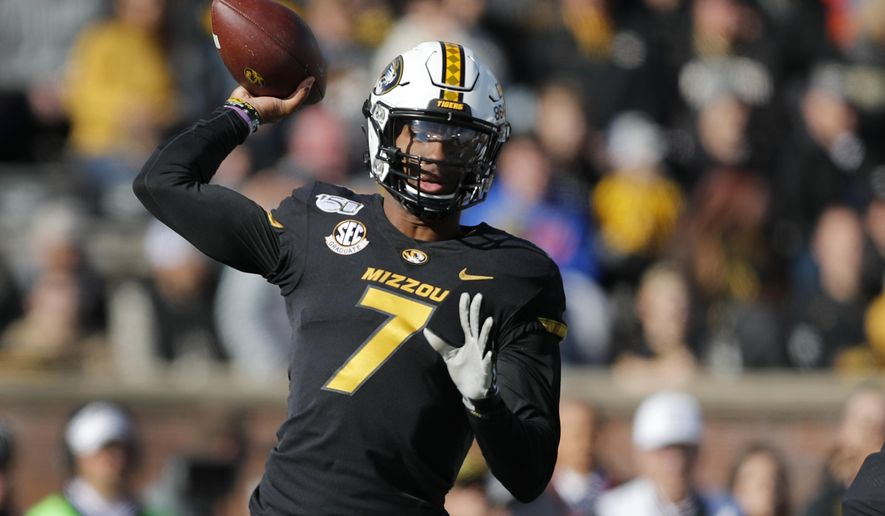 Missouri quarterback Kelly Bryant throws during the first half of an NCAA college football game against Florida, Saturday, Nov. 16, 2019, in Columbia, Mo. (AP Photo/Jeff Roberson)