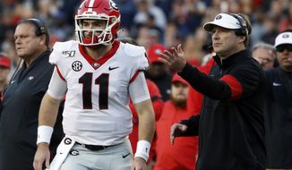 Georgia quarterback Jake Fromm (11) talks with head coach Kirby Smart during the first half of an NCAA college football game, Saturday, Nov. 16, 2019, in Auburn, Ala. (AP Photo/Butch Dill)