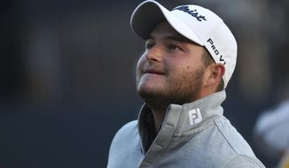 FILE - In this Friday July 20, 2018 file photo, Zander Lombard of South Africa finishes the second round of the British Open Golf Championship in Carnoustie, Scotland. Zander Lombard will take a one-shot lead into the final round of the Nedbank Golf Challenge and is in position to win his first European Tour title at his country's most prestigious tournament. The 24-year-old South African, who led by two strokes overnight, ground out a level-par 72 in the third round on Saturday, Nov. 16, 2019 to move to 11 under par. (AP Photo/Jon Super, file)
