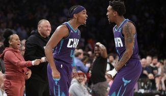 Charlotte Hornets' Devonte' Graham, left, and teammate Malik Monk celebrate after Graham made a 3-point basket during the second half of an NBA basketball game against the New York Knicks, Saturday, Nov. 16, 2019, in New York. The Hornets won 103-102. (AP Photo/Frank Franklin II)