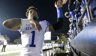 Kentucky's Lynn Bowden Jr. celebrates with fans after an NCAA college football game against Vanderbilt, Saturday, Nov. 16, 2019, in Nashville, Tenn. (AP Photo/Mark Humphrey)