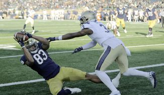 Notre Dame wide receiver Chase Claypool (83) makes a touchdown reception against Navy cornerback Cameron Kinley (3) during the first half of an NCAA college football game, Saturday, Nov. 16, 2019, in South Bend, Ind.(AP Photo/Darron Cummings) ** FILE **