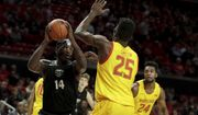 Oakland forward Xavier Hill-Mais (14) goes up for a shot against Maryland forward Jalen Smith (25) during the first half of an NCAA college basketball game, Saturday, Nov. 16, 2019, in College Park, Md. (AP Photo/Julio Cortez)