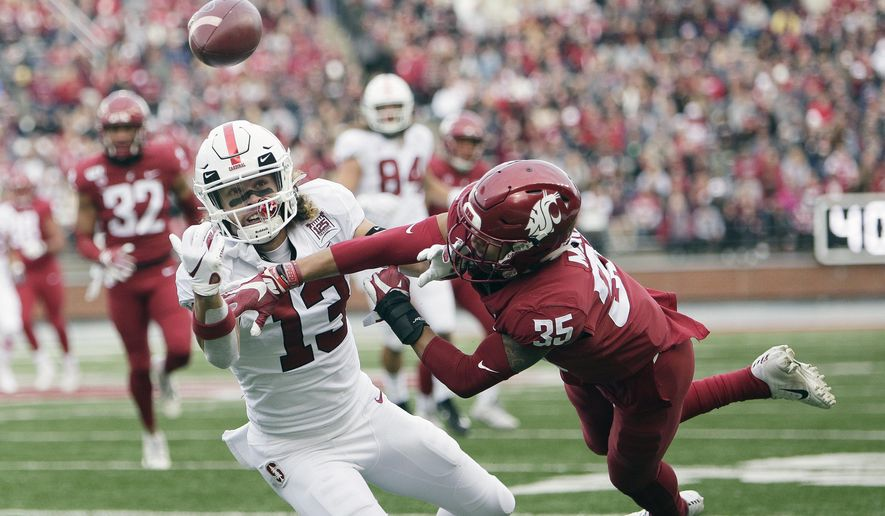 Washington State cornerback Armani Marsh (35) disrupts a pass intended for Stanford wide receiver Simi Fehoko (13) during the first half of an NCAA college football game in Pullman, Wash., Saturday, Nov. 16, 2019. (AP Photo/Young Kwak)