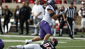 TCU's Wyatt Harris (25) intercepts a pass over Texas Tech's Erik Ezukanma (84) during the first half of an NCAA college football game Saturday, Nov. 16, 2019, in Lubbock, Texas. (Brad Tollefson/Lubbock Avalanche-Journal via AP)