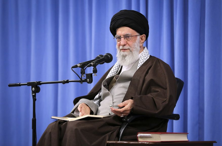 """In this picture released by an official website of the office of the Iranian supreme leader, Supreme Leader Ayatollah Ali Khamenei talks to clerics in his Islamic thoughts class in Tehran, Iran, Sunday, Nov. 17, 2019. Iran's supreme leader on Sunday backed the government's decision to raise gasoline prices and called angry protesters who have been setting fire to public property over the hike """"thugs,"""" signaling a potential crackdown on the demonstrations. (Office of the Iranian Supreme Leader via AP)"""