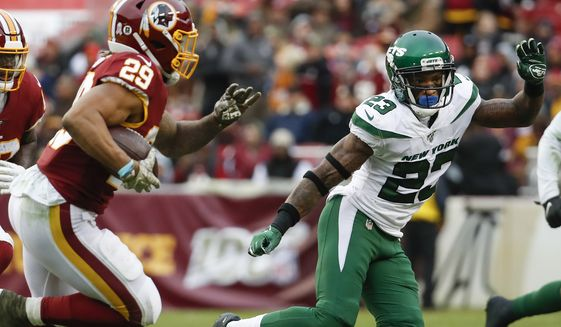Washington Redskins running back Derrius Guice (29) runs past New York Jets cornerback Arthur Maulet (23) for a touchdown during the second half of an NFL football game, Sunday, Nov. 17, 2019, in Landover, Md. (AP Photo/Alex Brandon)