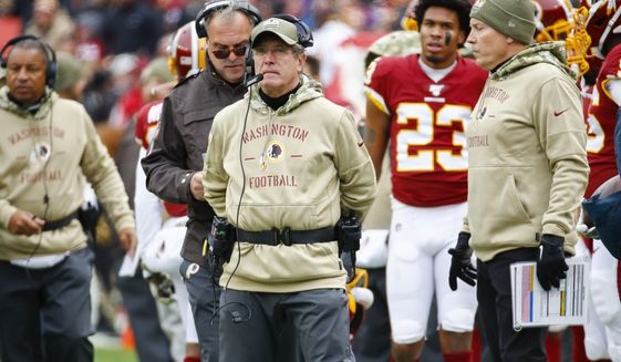 Washington Redskins interim head coach Bill Callahan on the sidelines during the first half of an NFL football game against the New York Jets, Sunday, Nov. 17, 2019, in Landover, Md. (AP Photo/Patrick Semansky)