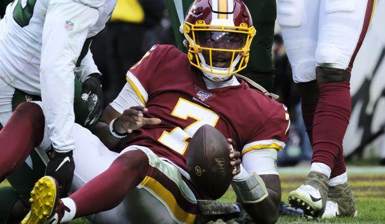 Washington Redskins quarterback Dwayne Haskins (7) is tackled short of the goal line during an NFL football game against the New York Jets, Sunday, Nov. 17, 2019, in Landover, Md. (AP Photo/Mark Tenally)