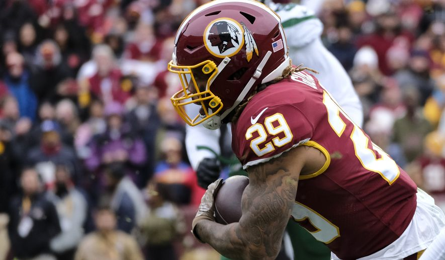 Washington Redskins running back Derrius Guice runs the ball during an NFL football game against the New York Jets, Sunday, Nov. 17, 2019, in Landover, Md. (AP Photo/Mark Tenally) ** FILE **