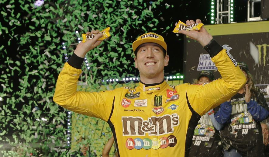 Kyle Busch celebrates in Victory Lane after winning a NASCAR Cup Series auto racing season championship on Sunday, Nov. 17, 2019, at Homestead-Miami Speedway in Homestead, Fla. (AP Photo/Terry Renna) ** FILE **