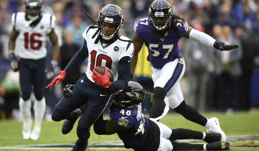 Houston Texans wide receiver DeAndre Hopkins (10) is tackled by Baltimore Ravens inside linebacker Patrick Onwuasor during the first half of an NFL football game, Sunday, Nov. 17, 2019, in Baltimore. (AP Photo/Nick Wass)