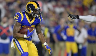 Los Angeles Rams running back Todd Gurley runs against the Chicago Bears during the first half of an NFL football game Sunday, Nov. 17, 2019, in Los Angeles. (AP Photo/Kyusung Gong)