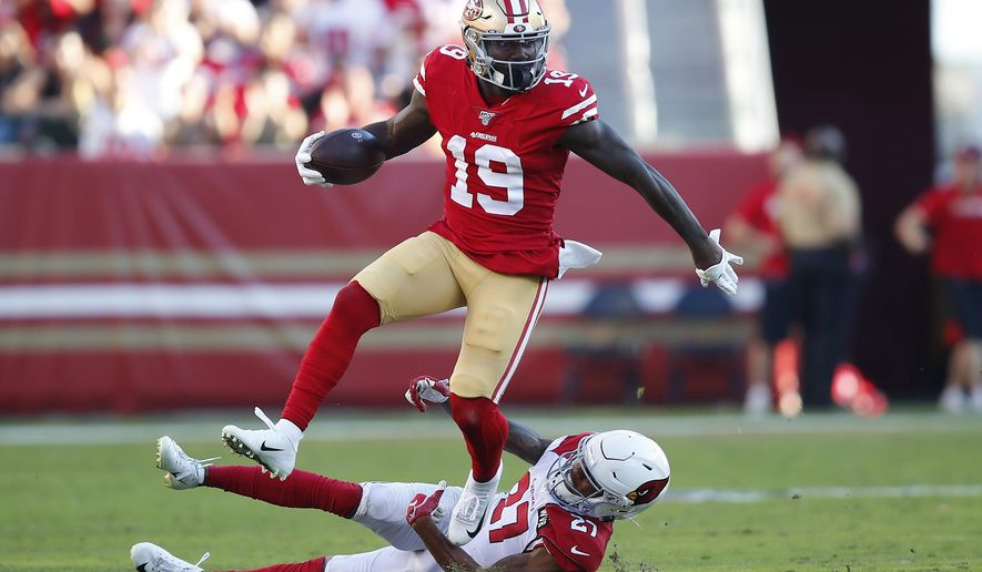 San Francisco 49ers wide receiver Deebo Samuel (19) runs against Arizona Cardinals cornerback Kevin Peterson (27) during the second half of an NFL football game in Santa Clara, Calif., Sunday, Nov. 17, 2019. (AP Photo/John Hefti)